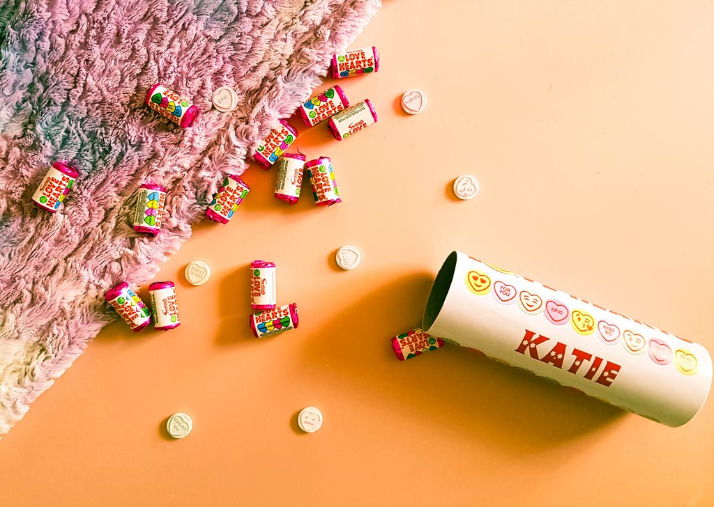 a personalised tube of love hearts